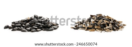 Sunflower seeds and husks on white background  - stock photo