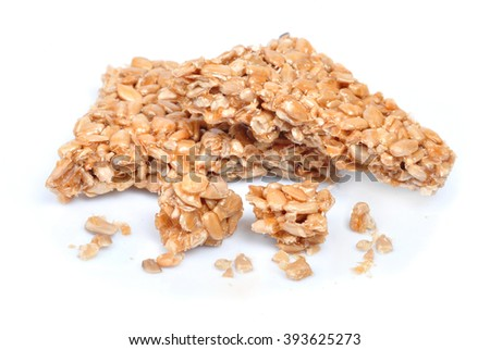 sunflower seeds in caramel on a white background