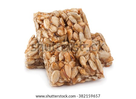 Sunflower seeds in sugar caramel isolated on white background