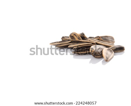 Sunflower seeds over white background