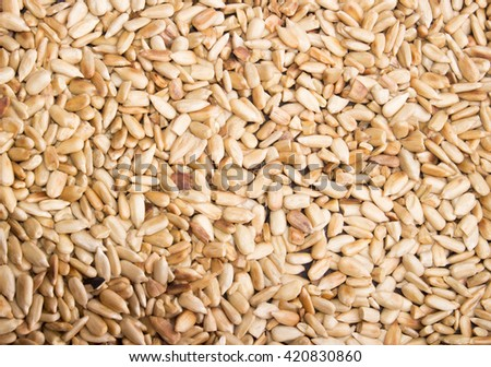 sunflower seeds, roasted sunflower seeds in a frying pan with