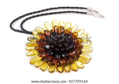 Sunflower shape amber brooch and necklace on the white background - stock photo