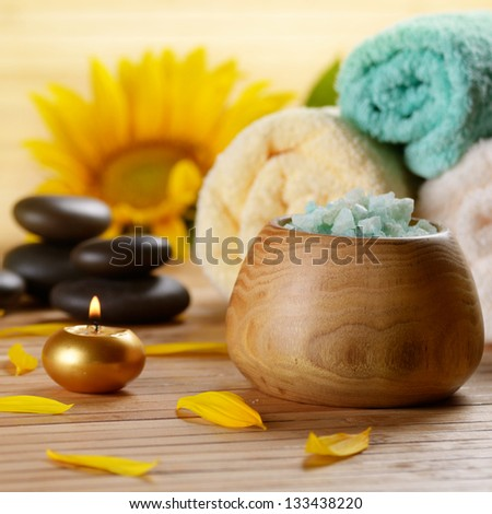 Sunflower spa set on the wooden table