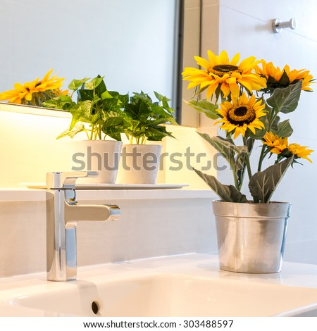 sunflower vase decorated on bathroom sink