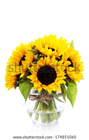 Sunflowers in a  vase over white - stock photo