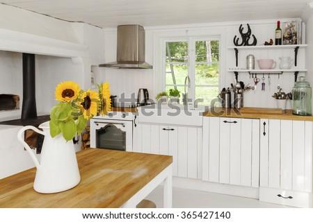sunflowers in kitchen - stock photo