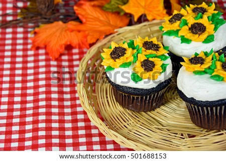 sunflowers on chocolate cupcakes with autumn leaves