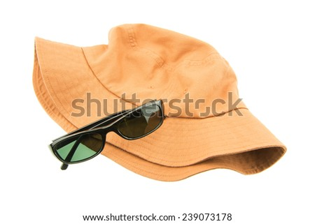 Sunglasses and Flat top cotton hat isolated on white background - stock photo