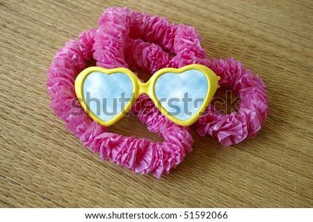Sunglasses and Lei - stock photo