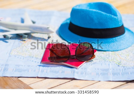 Sunglasses and passports, miniature airplane on the map. Travelling conception - stock photo