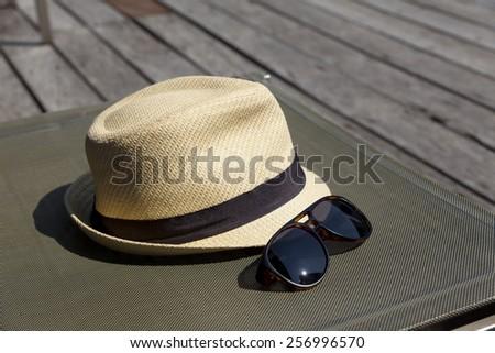 sunglasses and white sunhat. - stock photo