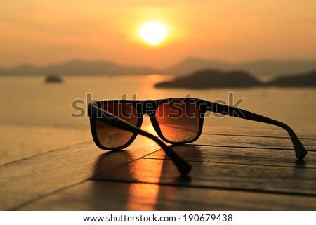 Sunglasses at Sunset - stock photo