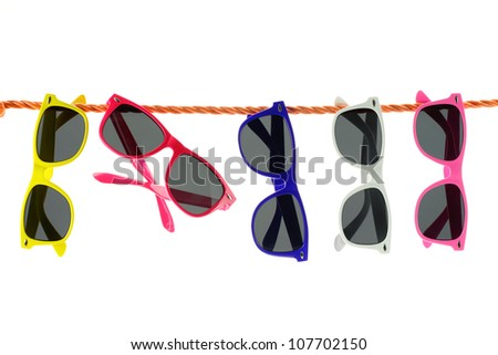Sunglasses hanging on a rope