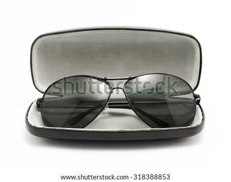 sunglasses in black opened case isolated on white background