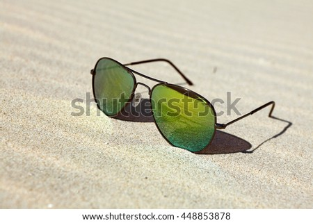 sunglasses in the sand at the beach - stock photo