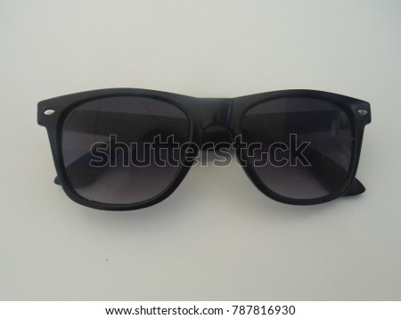 Sunglasses on a white table