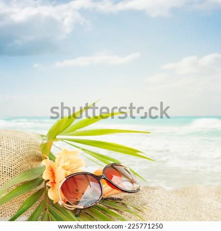 Sunglasses on the  sand beach - stock photo