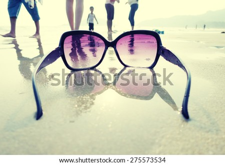 Sunglasses on the sand of Palolem beach. South Goa, India - stock photo