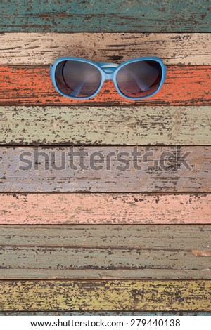 Sunglasses on vintage wood.Summer holiday background concept.Copy space - stock photo