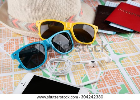 Sunglasses, passport and map, close up. Preparing for travel concept - stock photo