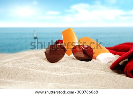 sunglasses red towel and sea
