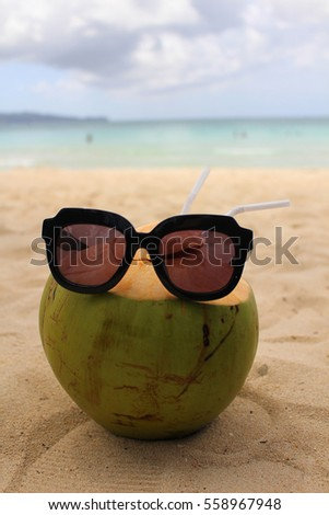 Sunglasses With Coconut in the beach, Philippines.