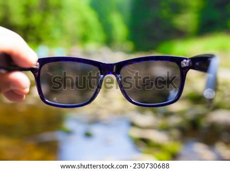Sunglasses with natural background. Vacation, holiday and traveling concept.