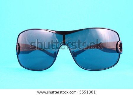 Sunglasses with tinted lenses on white