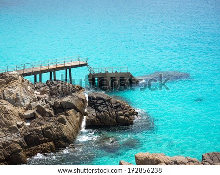 Sunken pier in the turquoise colored waters of Perhentian Kecil island, Malaysia.