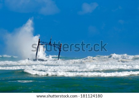 Sunken ship wreck and stormy sea - stock photo