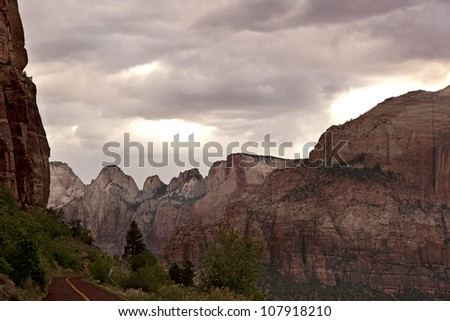 Sunlight emerges through a stormy sky. Zion National park, Utah, USA - stock photo