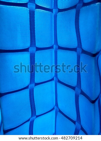 Sunlight getting through the blue squared curtain.