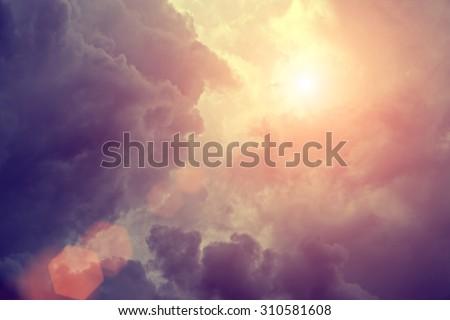 Sunlight in rain clouds - stock photo