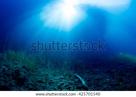 Sunlight into the water - stock photo