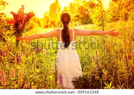 sunlight outstretched female with bunch - stock photo