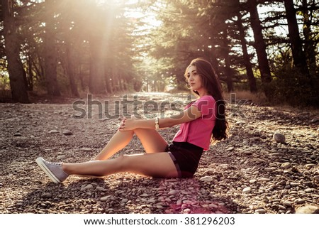 sunlight portrait of young beautiful and elegant stylish girl