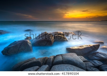 sunlight ray on rock at tropical beach of Lan Hin Khaow in Rayong province in east of Thailand - stock photo