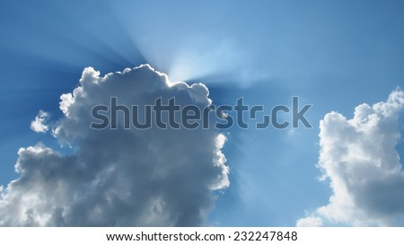 sunlight shining behind cloud sky - stock photo