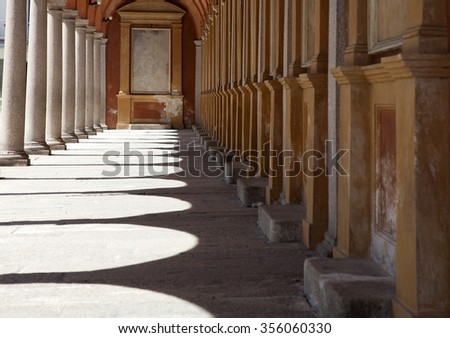 Sunlight through the arches of a corridor in a church - stock photo