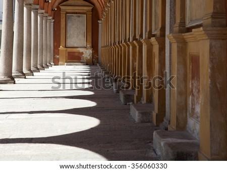 Sunlight through the arches of a corridor in a church - stock photo