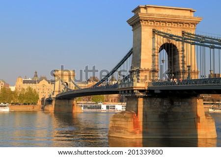 Sunlit Chain bridge at evening, Budapest, Hungary - stock photo