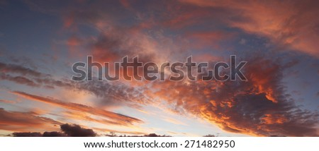Sunlit clouds in beautiful sky - stock photo