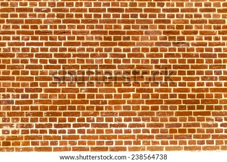Sunlit plain red brick wall - stock photo