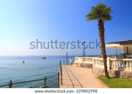 Sunlit promenade near the Adriatic sea, Opatija, Croatia - stock photo