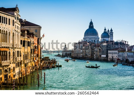 Sunlit view of Grand Canal in Venice, Italy, from the Academia Bridge - stock photo