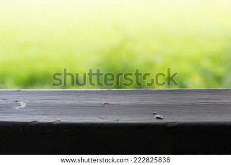 Sunny abstract green nature background with table, defocused  - stock photo