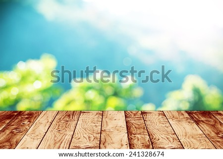 Sunny abstract green nature background, with wood terrace  - stock photo