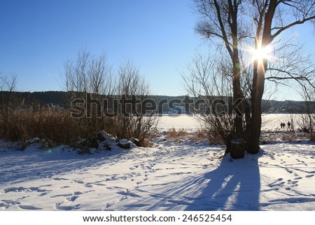 Sunny afternoon in winter at frozen lake