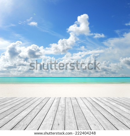 Sunny beach and empty wooden platform - stock photo