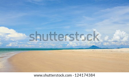 sunny beach, blue ocean and clean sky